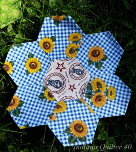 One English paper pieced flower in blues.