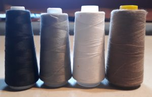 Four spools of serger thread.