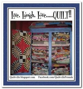 Photo of cupboard full of quilts with the words - live. laugh. love...quilt!