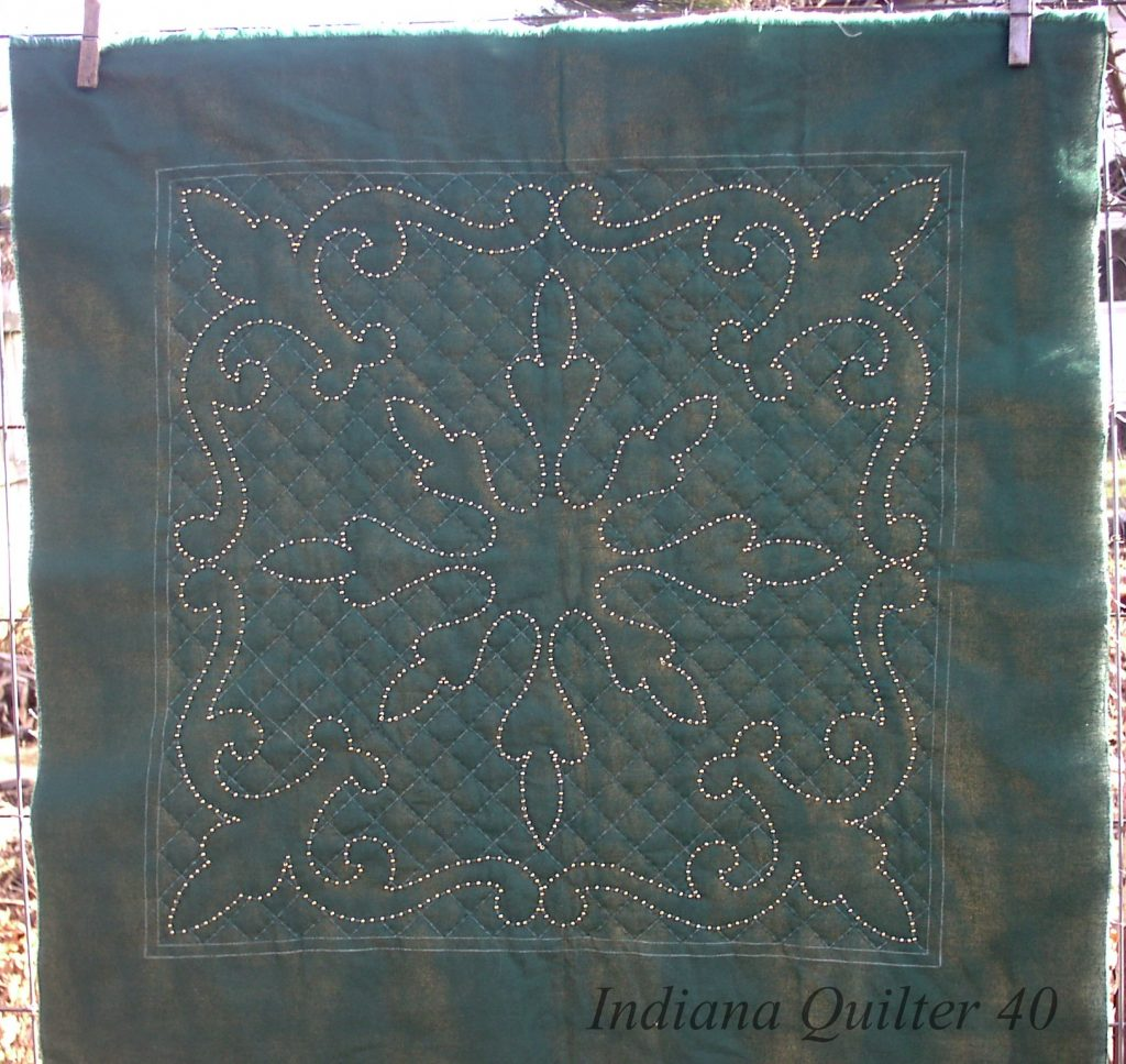 Queen's Crown #1 - Small quilt with beads.  Green solid with gold beads.