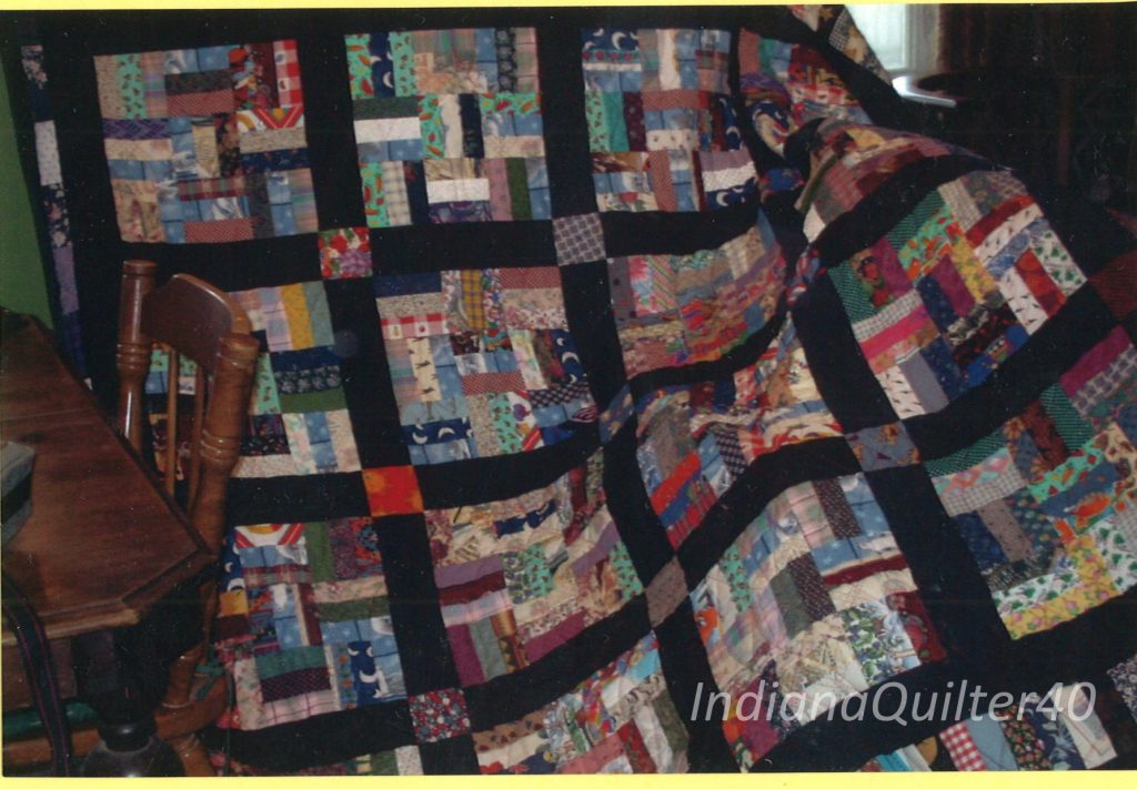 Scrap quilt - Basketweave Nine Patch with back sashing.