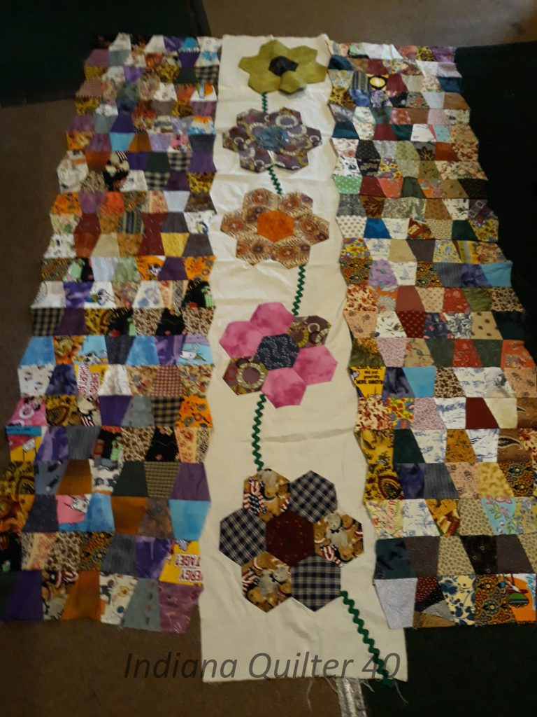 Two tumbler sections and one flower section of the quilt.