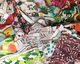Various colored fabric scraps in a pile.