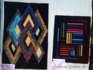 Two geometric quilts in solids or batik fabrics.