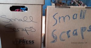 "Two cardboard boxes marked ""small scraps""."