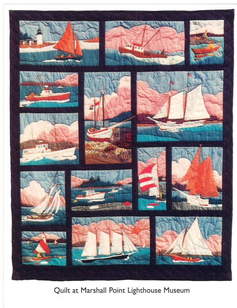 Pictorial quilt with various boats.