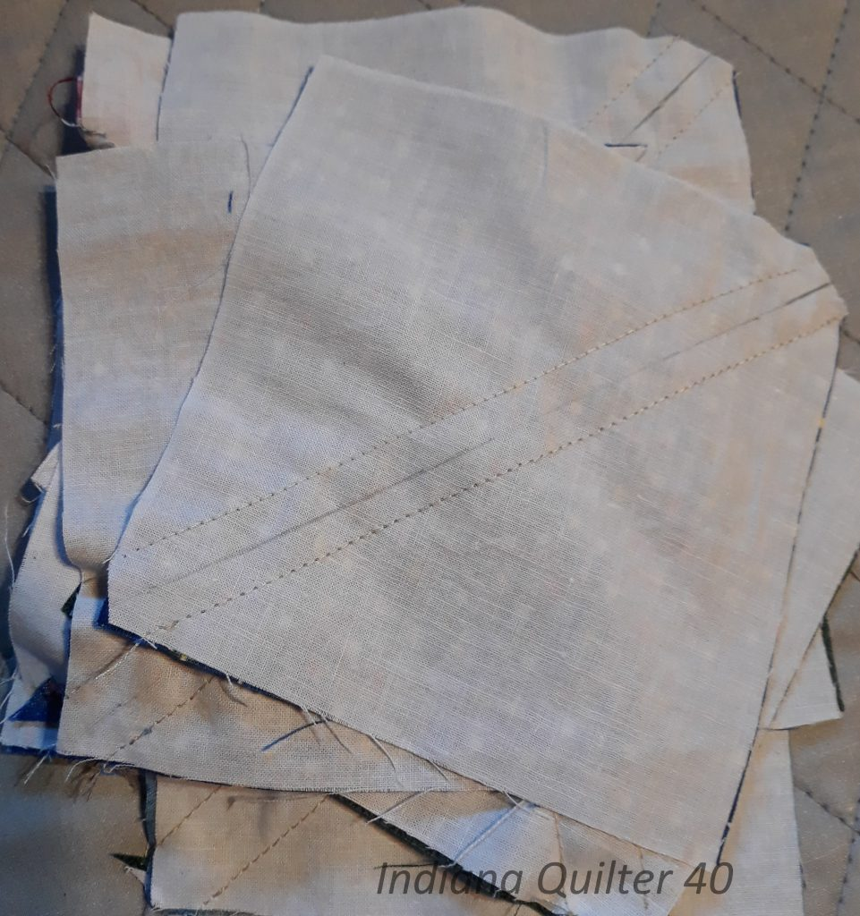 Half square triangles before being cut apart.