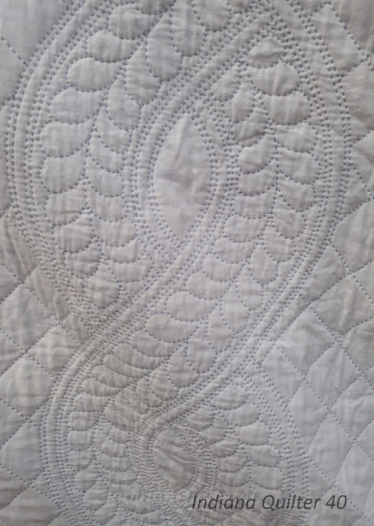 Quilted feathers in Queen Anne's Star Whole Cloth quilt.