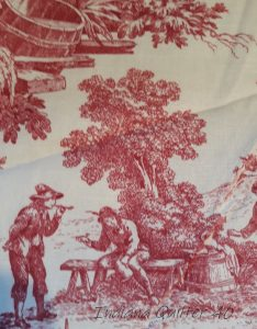 Toile fabric with white background and red scenery and people.
