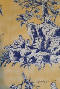 Toile with yellow background and blue scenery and people.