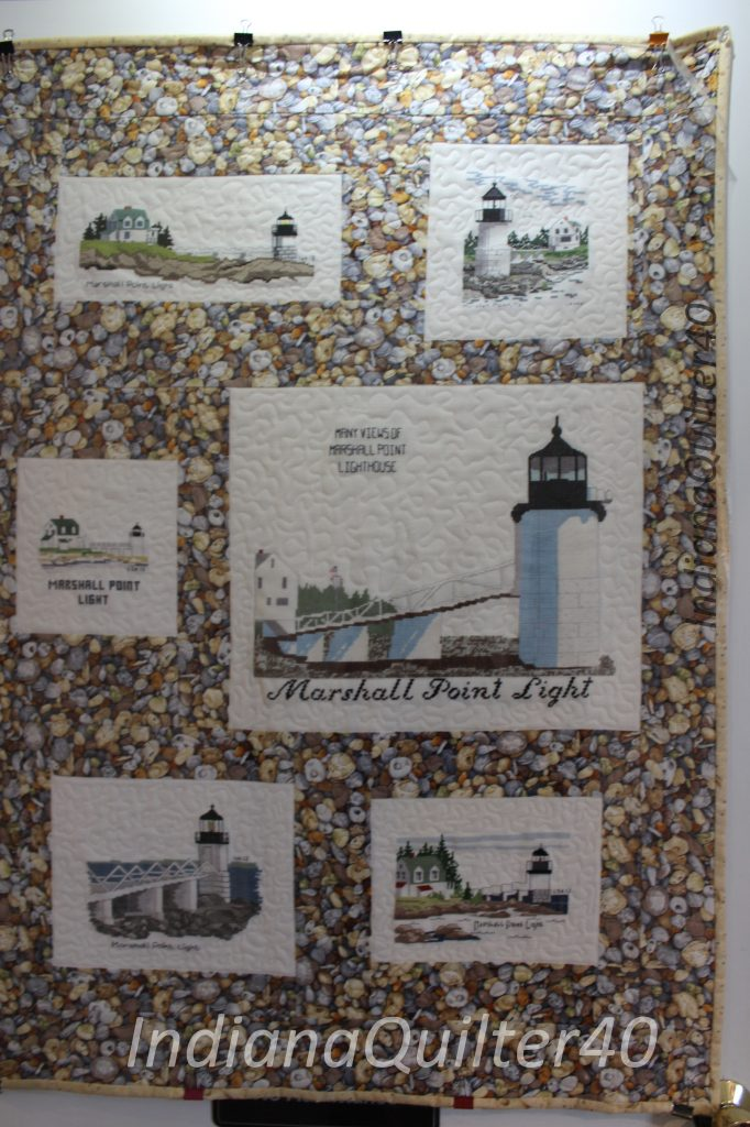 Counted cross stitch blocks of lighthouses with pebble fabric machine quilted wall hanging