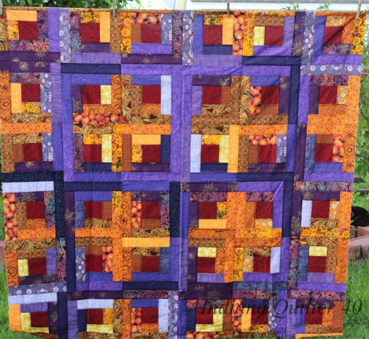 36 blocks sewn together for LOG CABIN IN THE FALL WOODS