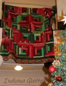 Lettuce Be Berry (a green and red log cabin quilt).