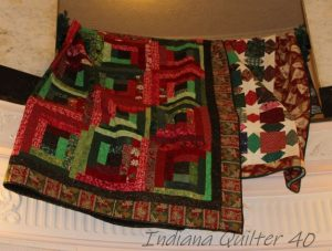 Two Christmas quilts in red and green.