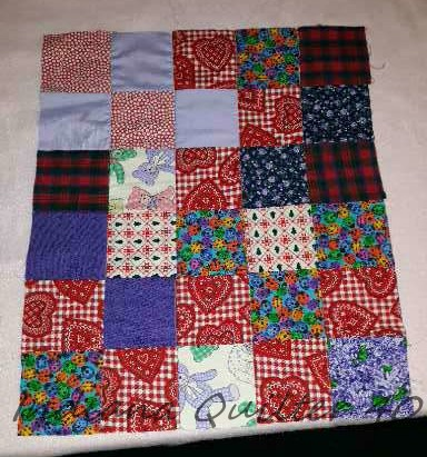 All the blocks in the doll quilt sewn together.