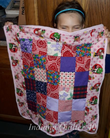Happy grand with second doll quilt made in a day.