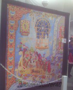 A detailed Santa quilt.