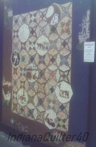 Brown quilt with applique motifs.