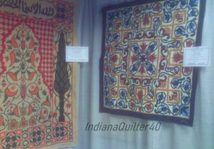 Two quilts made by Egyptian quilt makers.