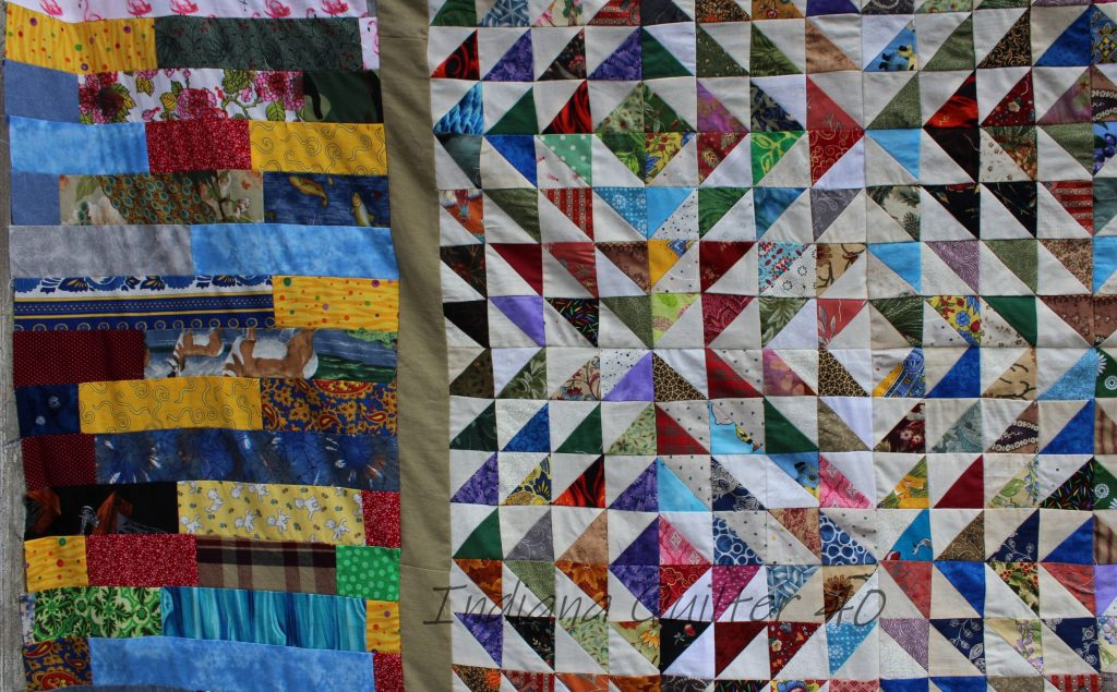Close up of piano key border and the triangle blocks of the Scrap Bonanza #1 quilt top