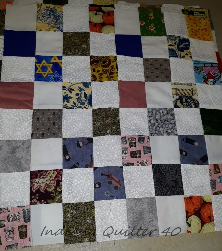 Scraps squares within a quilt block.