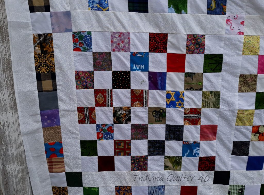 A quilt block with sashing and posts.  Also the 3 borders.