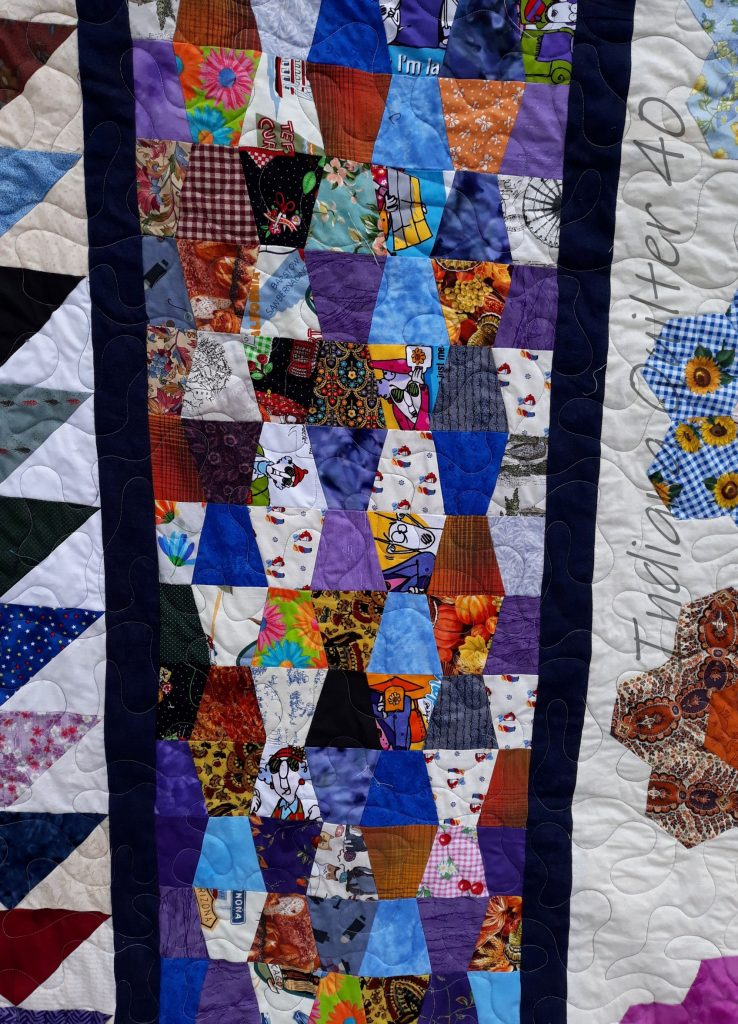 Close up of tumbler section of quilt