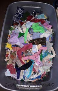 Bin full of colorful scraps of fabric.