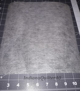 """10"""" square of foundation material for  Happy Hibernation Quilt."""