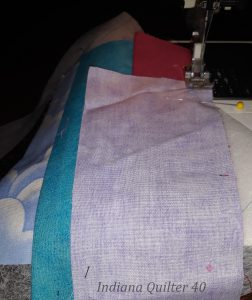 Sewing on the piece that will cover the first corner of the crumb block.