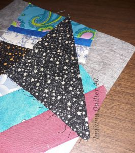 Sewing down the corner piece on this crumb quilt.