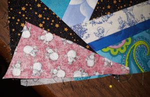 Fabric laid out to sew down to cover corner of crumb block.