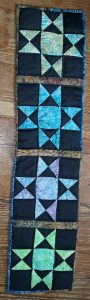 Indiana Quilter 40 Reader Gallery: Ohio Star quilted table runner.