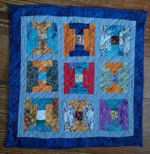 Small quilt of courthouse blocks. in section Readers Gallery of Indiana Quilter 40.