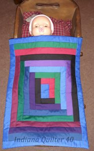 Amish colored doll quilt.
