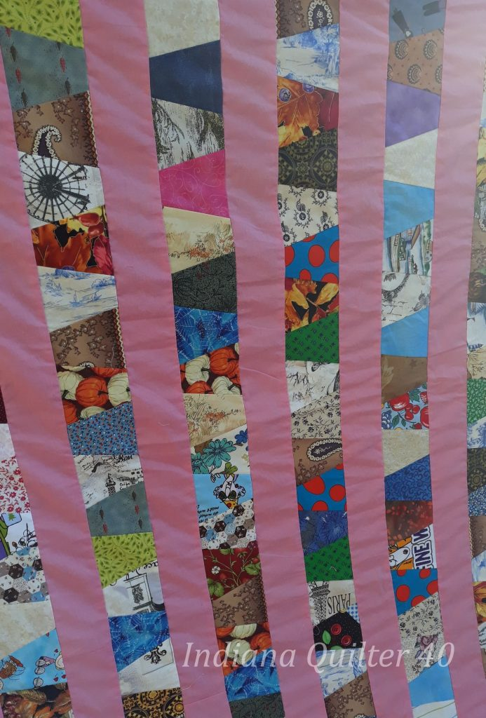 Days Are Tumbling By Quilt.  Sashing between the rows of tumblers.