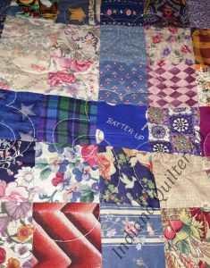 More charm squares sewn together for quilt.