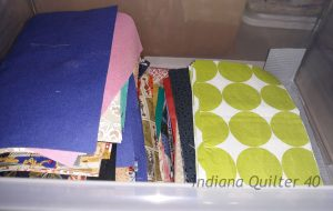 "Bin of 4"" x 7"" scrap rectangles for quilting."