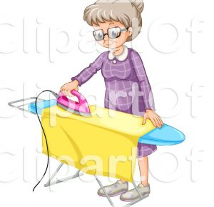 woman ironing fabric to cut out quilt pieces