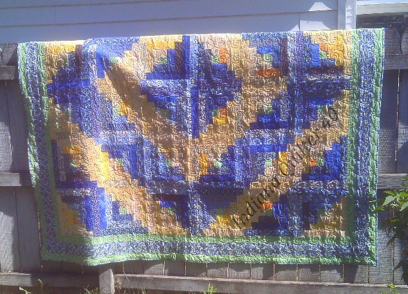 Sunshine and Maine Blueberries log cabin quilt