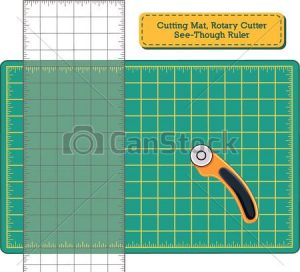 Rotary mat with ruler and rotary cutter for cutting quilt pieces.