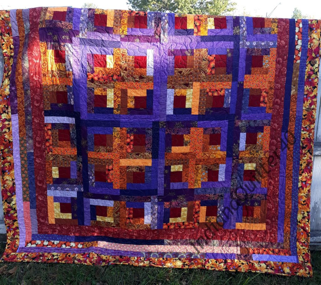 Completed Log Cabin in the Fall Woods quilt.