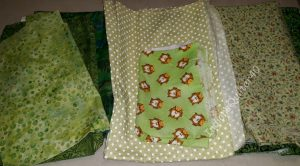 Green fabrics for the mystery quilt.