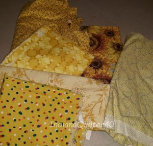 Yellows fabrics for the quilt.