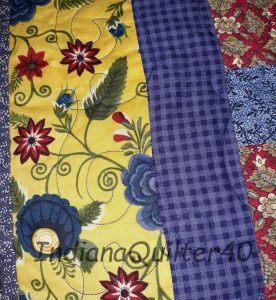 two borders: blue checked and yellow floral.