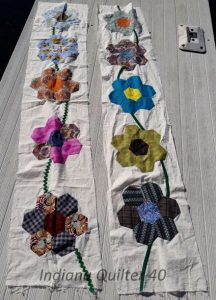 Two panels of pieced flowers for this quilt.