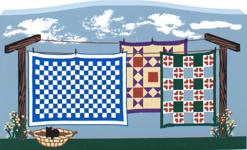 Quilts on wash line.