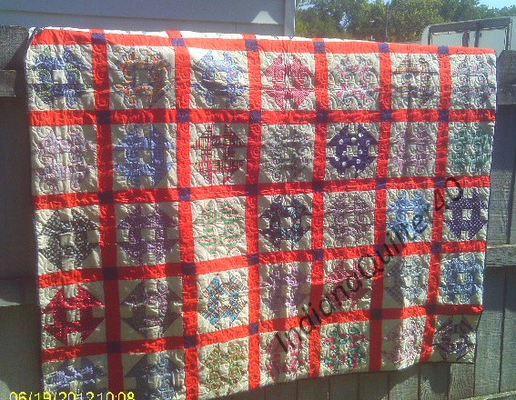 Cheerful colors make this quilt top.