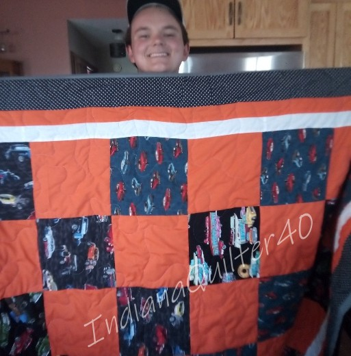 Nephew is happy with the quilt.