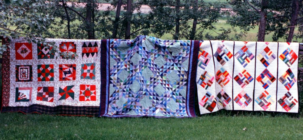 Christmas Sampler, Ocean Wave, and 9 Patch Basket Weave quilts